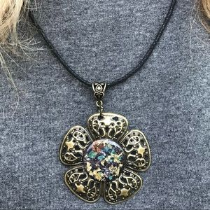 Jewelry - Antique gold filigree flower with metallic disc .